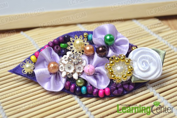 finished leaf-shaped hair clip with flowers