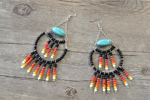 final look of the stylish black seed bead hoop earrings