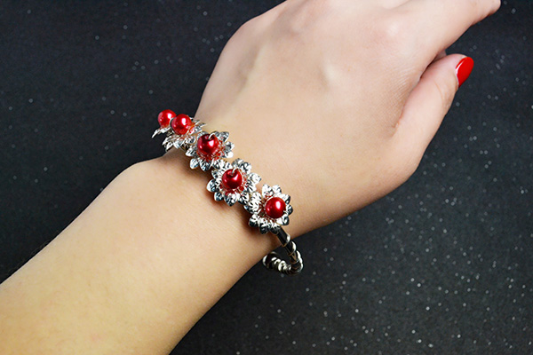 final look of the silver flower bangle bracelet with red pearl beads