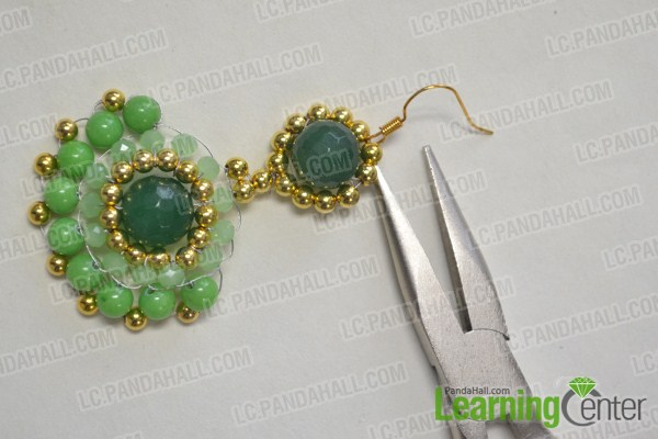 Add an earring hook to the top side.