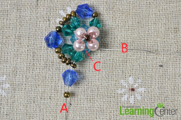 continue sliding beads onto wire