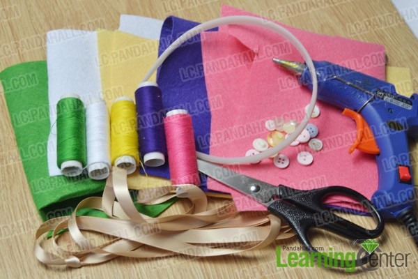 materials and tools for making a felt flower baby headband