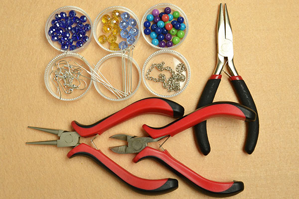 Materials and tools needed for glass and jade beads earrings: