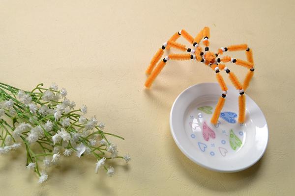 final look of the orange chenille stem spider craft