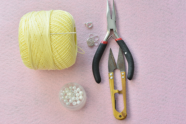 supplies in making the handmade yellow string flower bracelet