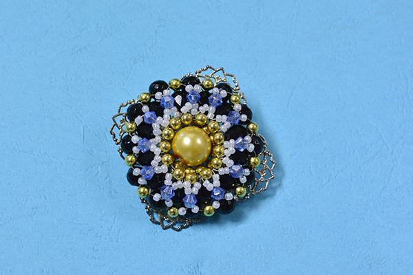 final look of the blue rhombus beaded flower brooch