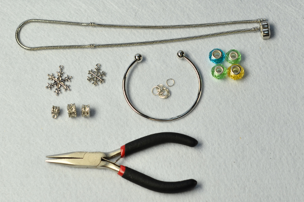 Materials and tools needed for Tibetan snowflake bangle and European beads necklace: