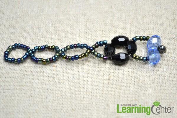 start to slide light blue glass beads