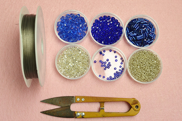 Supplies needed to make the blue glass bead ring: