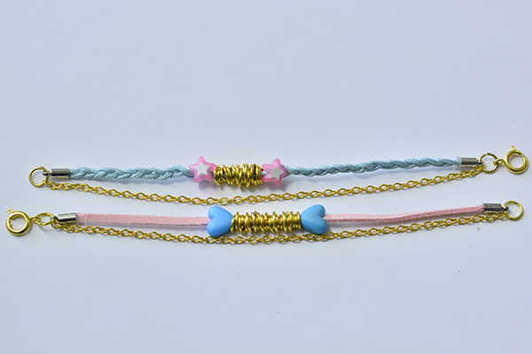 final look of the pink and light cyan cord and golden chain bracelets