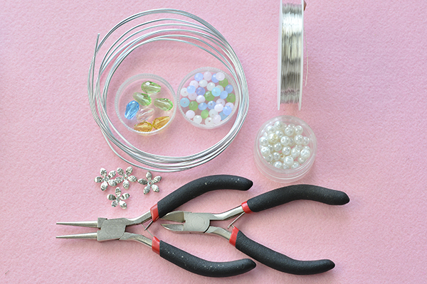 Supplies in making the wire wrapped glass bead flower cuff bracelet: