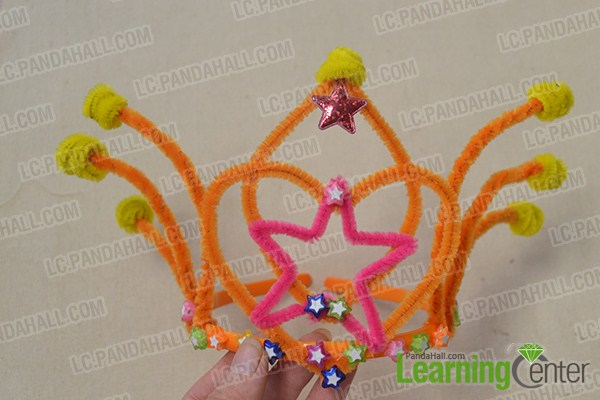 Add some star beads to the hair band.