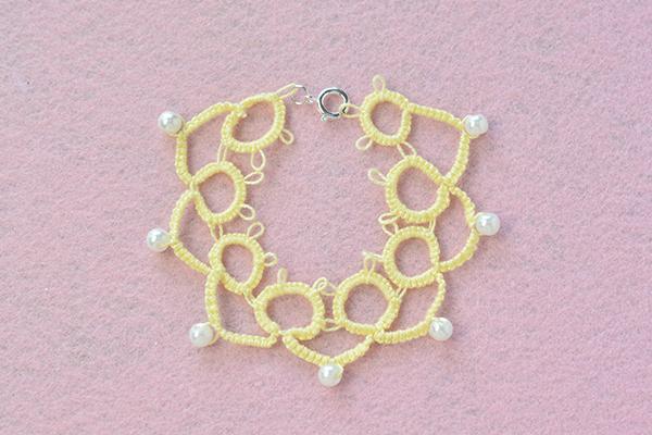 final look of the handmade yellow string flower friendship bracelet