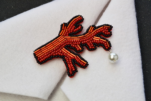 final look of the embroidery seed beaded coral brooch