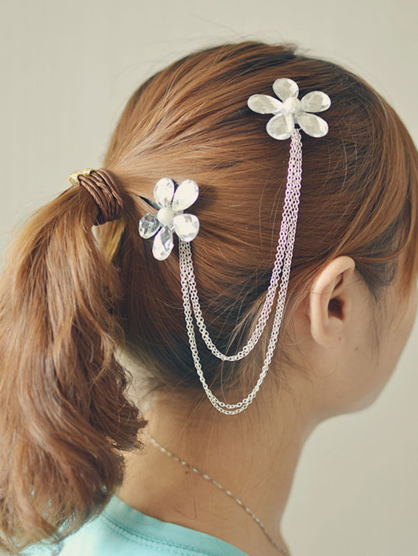 a beautiful flower hair clip with chain linked