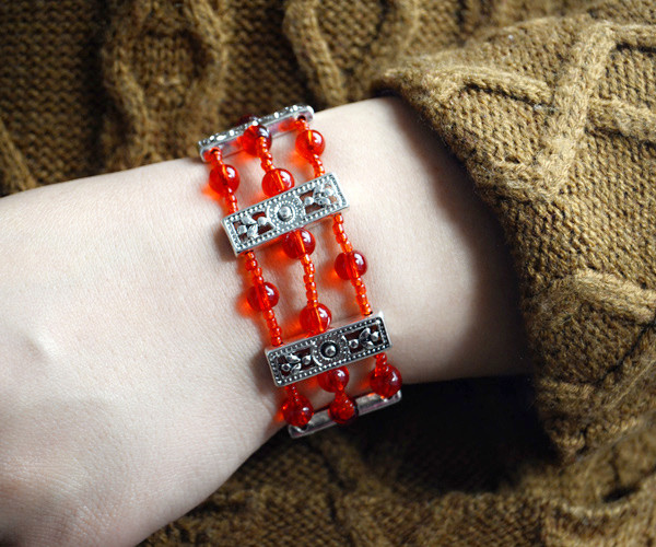 Wear this simple but beautiful red multi strand beaded bracelet: