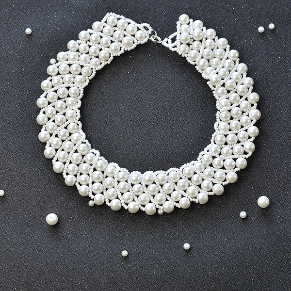 final look of the white pear bead statement necklace