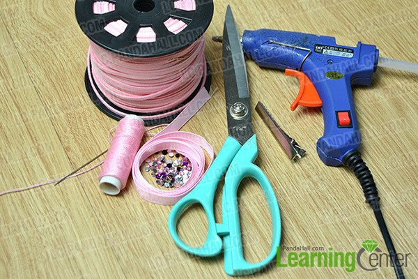 materials and tools for making pink butterfly hair clips