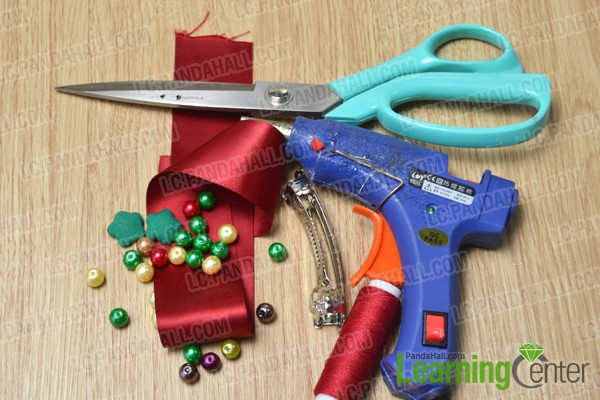 Materials and tools for making a Christmas folded red ribbon hair clip
