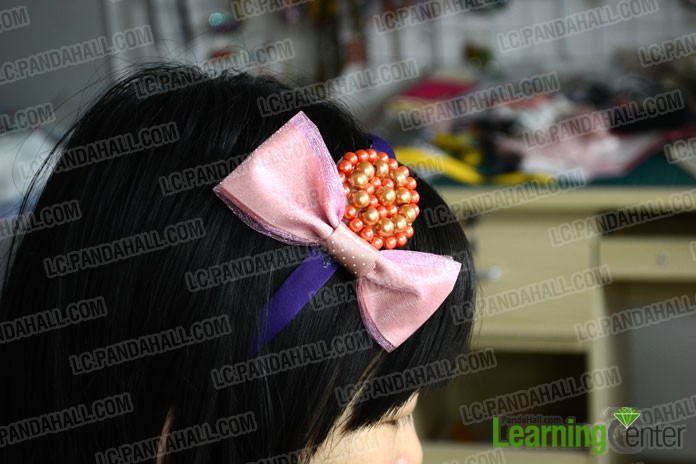 Adorn the headband with two decorations