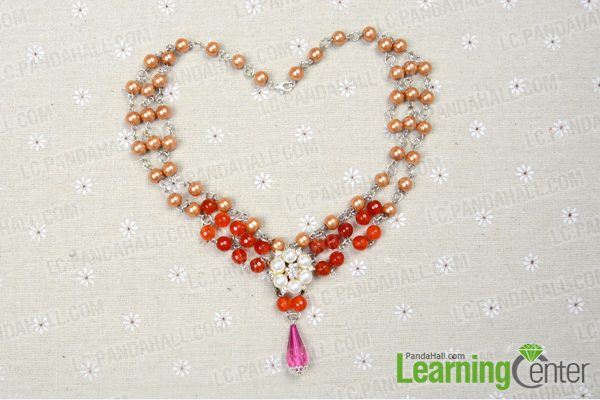 Put the flower pearl pendant to the multi bead necklace
