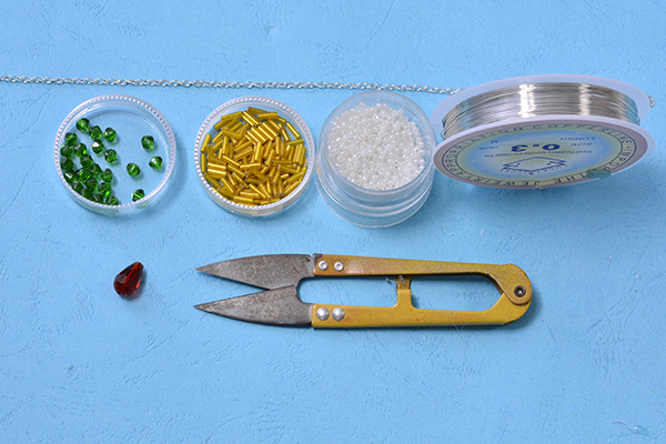 Supplies in making the colorful beaded snowflake pendent necklace:
