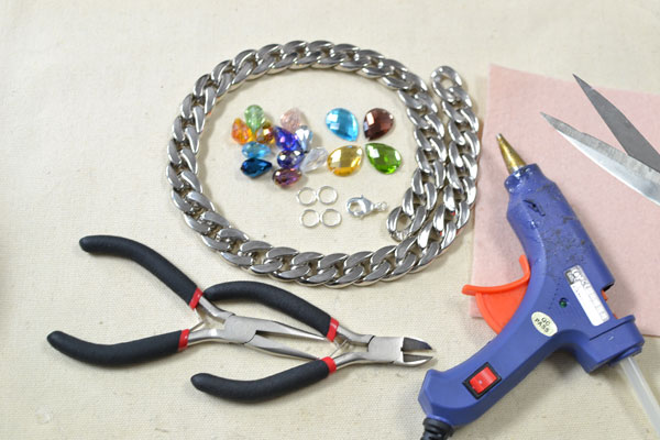 Materials and tools on how to make a chain statement necklace with multi colored beads: