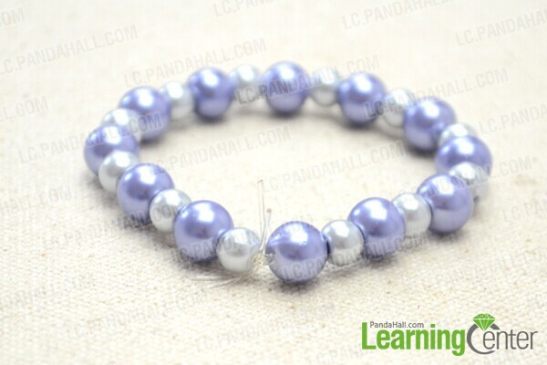 knot ends to make elastic pearl bracelet