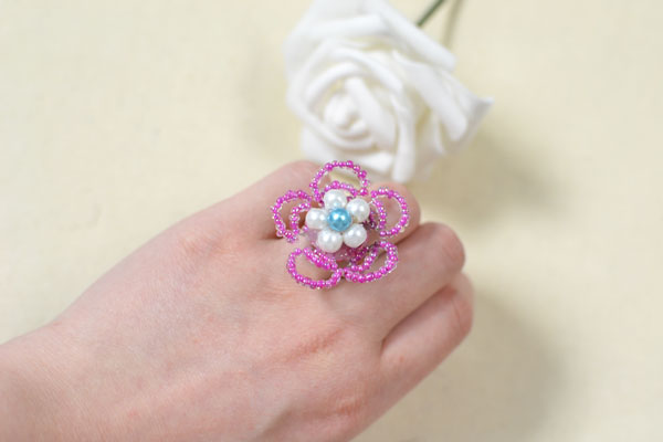 A beautiful beaded flower ring comes out after these steps: