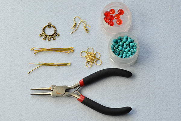 Tools and materials needed to make the turquoise bead chandelier earrings: