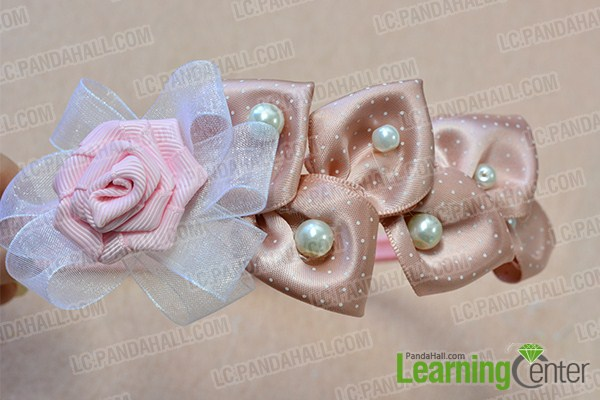 add the pink flower and white pearl beads
