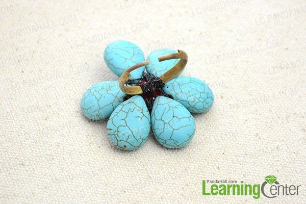 wrap the flower onto the ring