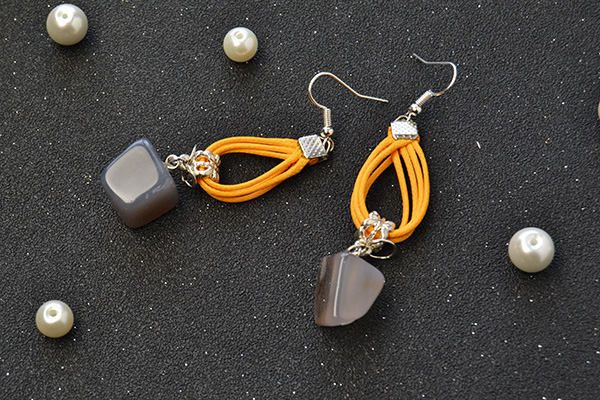 Another picture for the orange dangle earrings.