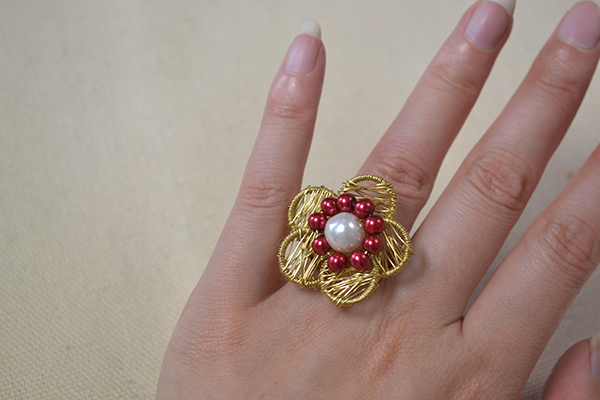 Just with 2 steps, this wire wrapped pearl flower ring is finished! Do you like it?
