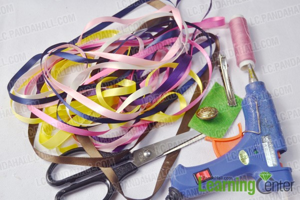 materials and tools for making a colorful ribbon hair clip