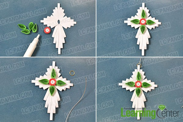 attach the red pattern and the green leafs onto the white cross