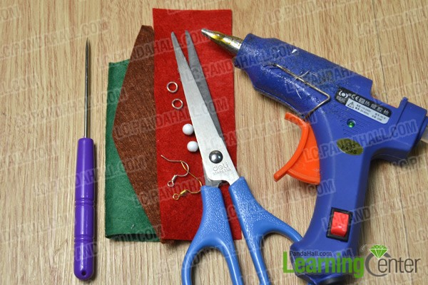 materials and tools for making Christmas tree earrings