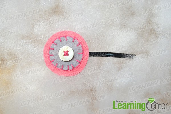 finished simply embroidered round felt hair clip