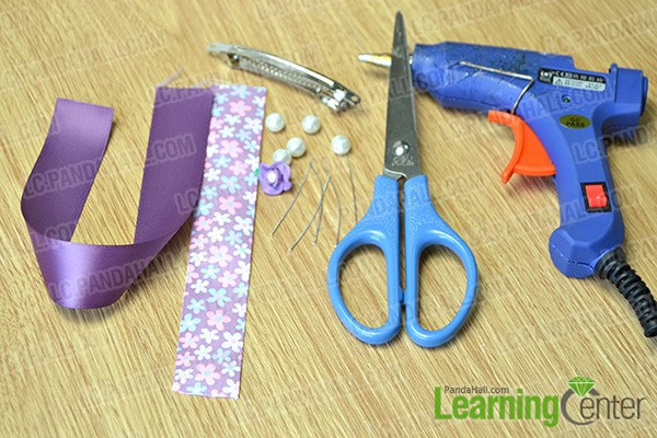 materials and tools for making purple ribbon bow hair clip