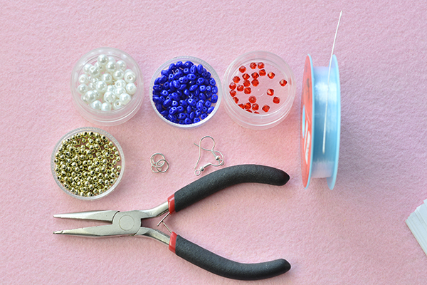Materials needed for the beading earrings with pearl and 2-hole seed beads: