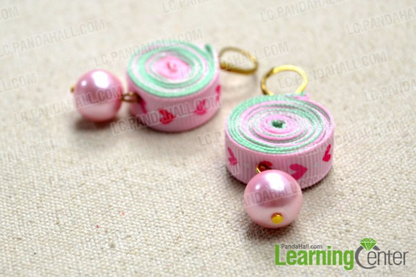complete the pair of pink ribbon earrings