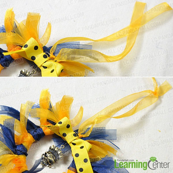 Add a yellow ribbon to the middle part of the circle to hang the decoration.