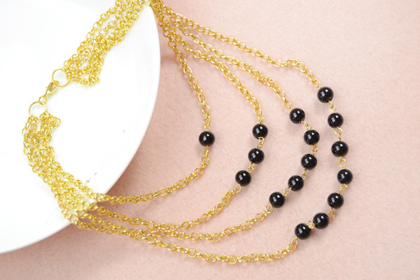 The final look of the fashion multi strand gold chain necklace