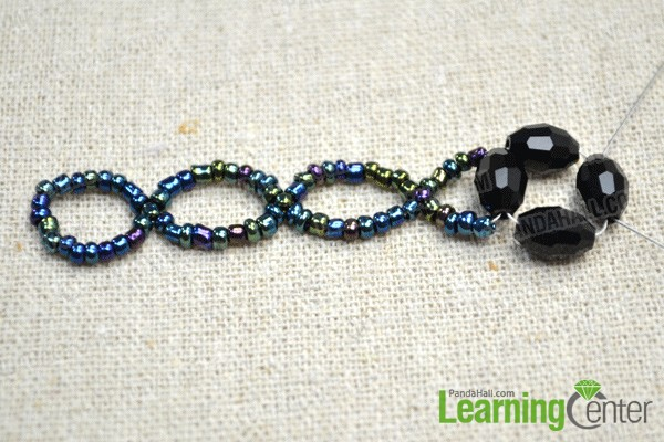 make a circle with 4 black glass beads