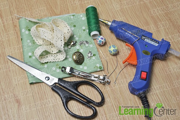 materials and tools for making flower hair clips with polymer clay beads