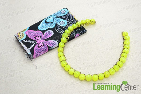 wrap chain onto the yellow bead necklace