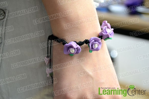 finished Spiral Knot Bracelet with Purple Polymer Clay Flower Beads