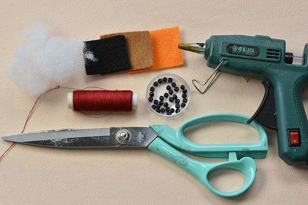 Supplies needed for this felt doll with black pearl beads making: