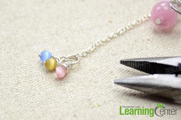Attach three 4mm cat eye bead dangles
