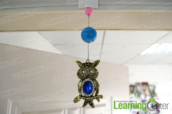 find the center of door and then stick the owl pendant bunch